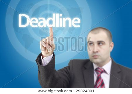 Business Man Pressing On Deadline Word