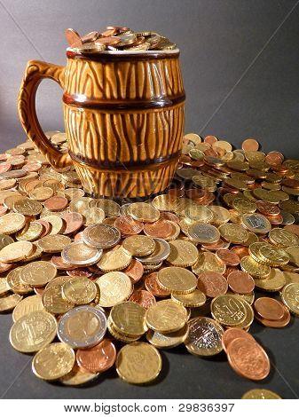 Coins in a beer mug
