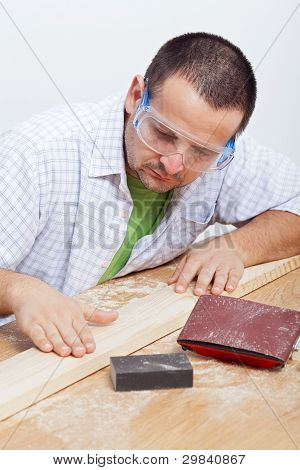 Man Furbishing Wooden Planck