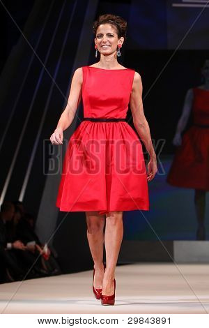 NEW YORK - FEBRUARY 8: Glamour magazine editor Cindi Leive wears Jason Wu at The Heart Truth's Red Dress Collection 2012 Fashion Show at the Hammerstein Ballroom on February 8, 2012 in New York City.
