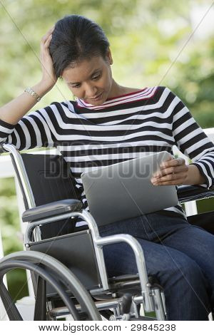 Disabled Woman With Digital Tablet