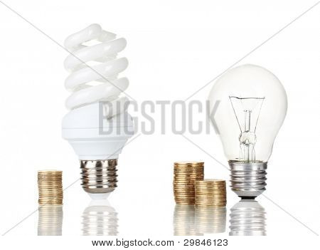 Comparison of ordinary light bulbs with energy saving lamp isolated on white