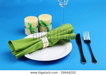 Table setting on blue background