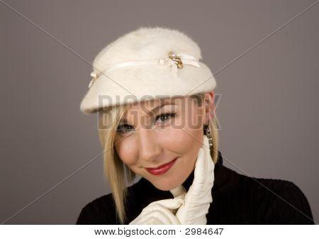 Blonde Fur Hat Glove On Cheek