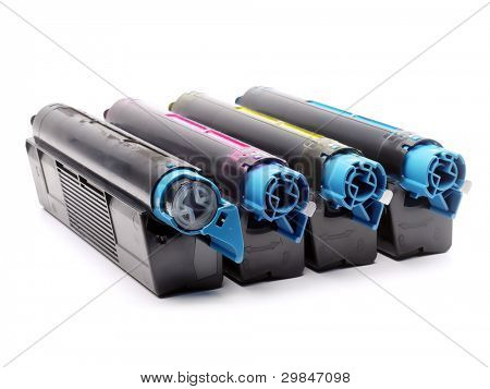 Four used laser printer toner cartridges of Cyan, Magenta, Yellow and black color shot over white background