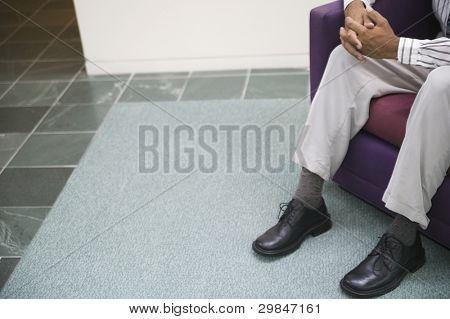 Low section of businessman sitting