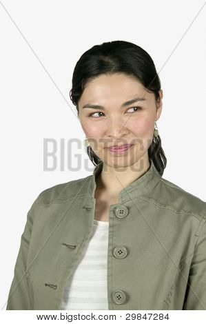 Portrait of a young woman looking at the side grinning