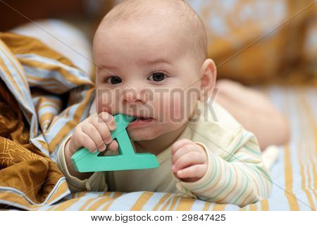 Boy Biting Letter