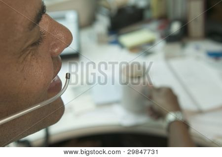 Close up of businessman with earpiece at office