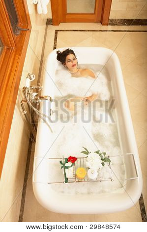High angle view of woman in bathtub