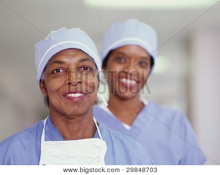 Two female surgeons smiling