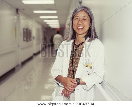 Mature female doctor in hospital hallway