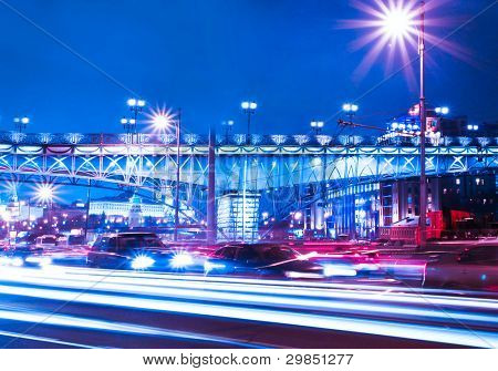 urban city at night with freeway traffic lights