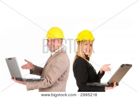 Couple Of Architect With Notebooks