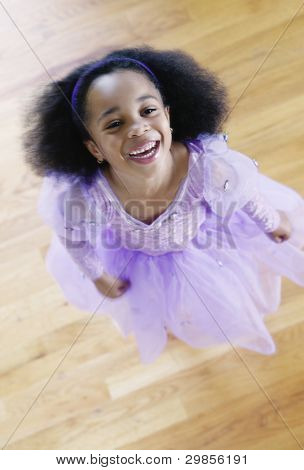 Portrait of a girl in a ballet outfit looking up laughing