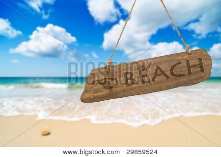 Idyllic beach with blue sky and fluffy white clouds