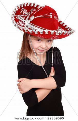 little girl in a red cowboy hat