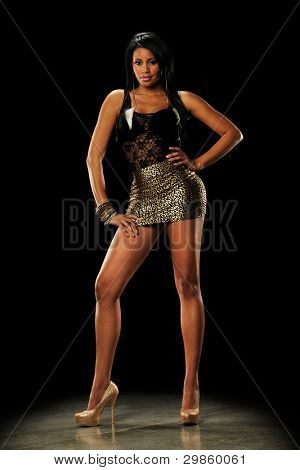 Young Black Woman wearing a mini skirt n a dark background