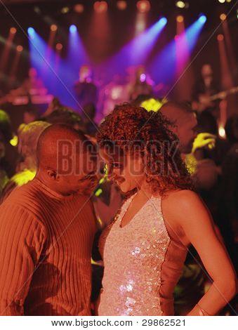Couple dancing at nightclub