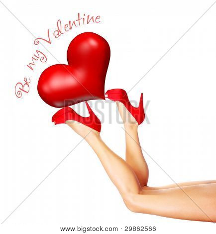 Beautiful sexy female legs holding up the big red heart, wearing stylish high heels isolated on white background with text space, Valentine's day romantic holiday, love concept