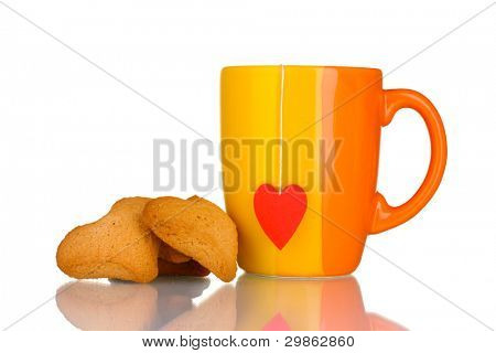 Orange cup with tea bag and heart-shaped cookies isolated on white