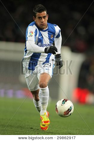 BARCELONA - FEB 4: Diego Ifran of Real Sociedad in action during the Spanish league match against FC Barcelona at the Camp Nou stadium on February 4, 2012 in Barcelona, Spain