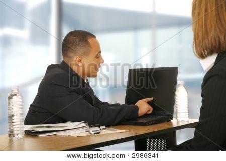 Business Man Showing Laptop