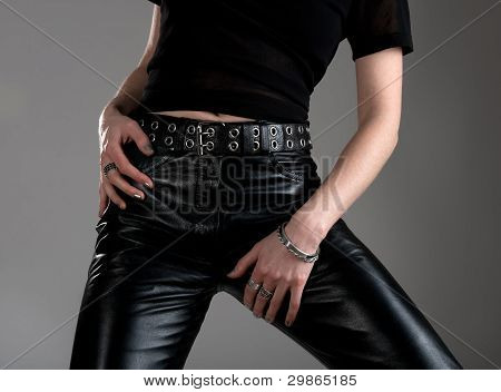 Young Woman In Black Leather Pants