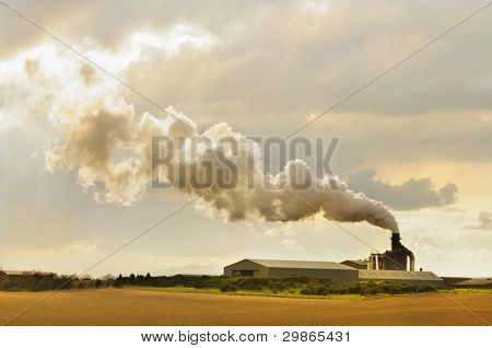 factory in Scotland belching out smoke creating pollution in the atmosphere
