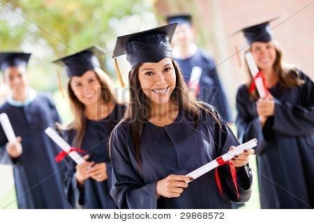 Group of people in their graduation day wearing a gown and mortarboard