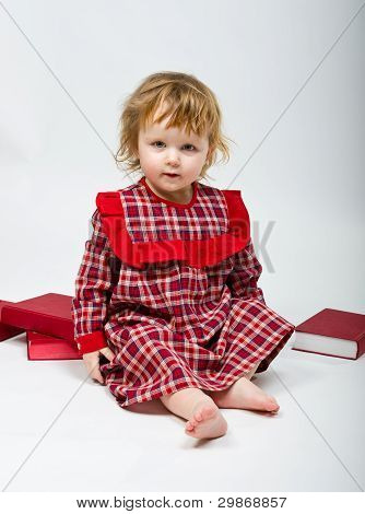 Cute Little Baby In Red Dress On White Bachground