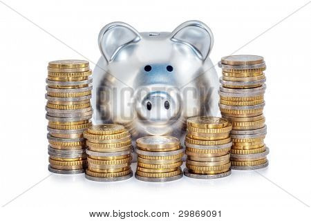Silver piggy bank behind piles of Euro coins, isolated on white background.