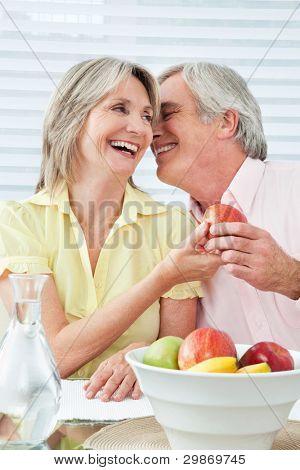 Senior couple in love flirting at breakfast table