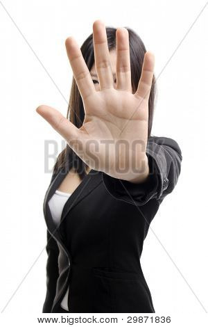 Serious business woman making stop sign over white background. Focus on hand