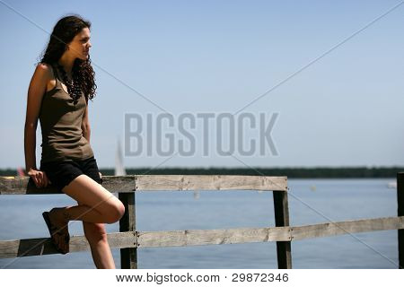Woman stood alone on jetty