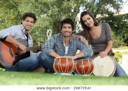 musical trio in green setting