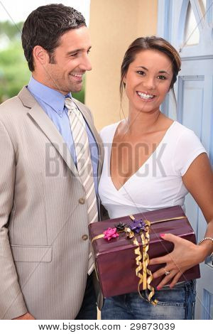 a beautiful woman received a gift from a well dressed man
