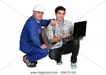 A tradesman helping his apprentice write a report of his experience
