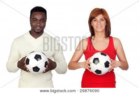 Beautiful redhead girl and attractive african men with a soccer ball isolated on a over white background