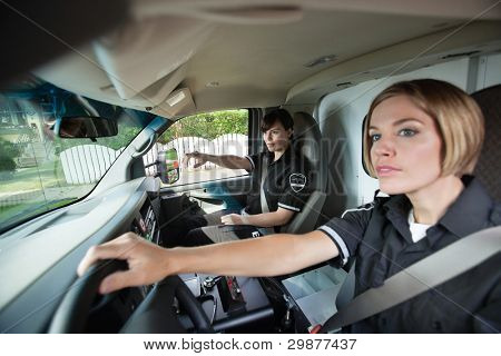 Two female EMS professionals driving to location