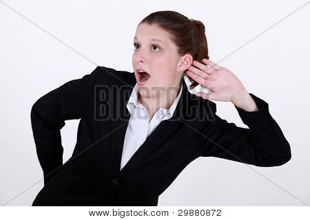 Businesswoman exaggerating listening