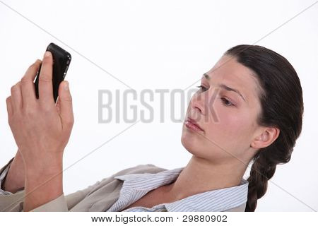 Businesswoman replying to text message