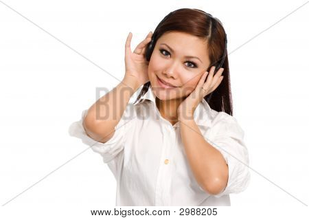Smiling Woman Listening On Her Headphone