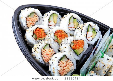 Japanese Style Sushi Boat With A Variety Of Sushi Rolls In A Plastic Container For Take Out