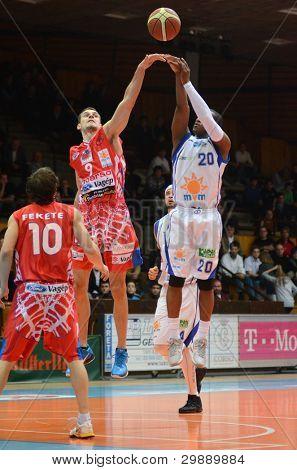 KAPOSVAR, HUNGARY - JANUARY 28: Kwadzo Ahelgebe (white 20) in action at a Hungarian Championship basketball game with Kaposvar (white) vs. Nyiregyhaza (red) on January 28, 2012 in Kaposvar, Hungary.