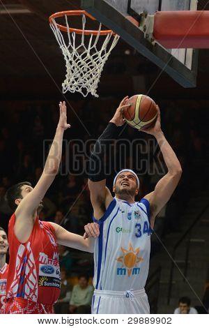 KAPOSVAR, HUNGARY - JANUARY 28: Michael Fey (with ball) in action at a Hungarian Championship basketball game with Kaposvar (white) vs. Nyiregyhaza (red) on January 28, 2012 in Kaposvar, Hungary.