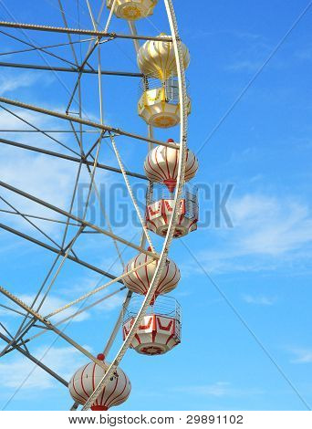 Ferris wheel against the blue sky