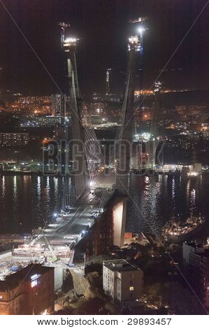 night view of construction of big guyed bridge in the Russian Vladivostok over the Golden Horn bay