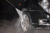 stock photo of car wash  - High pressure carwash system cleaning tyres and disks - JPG