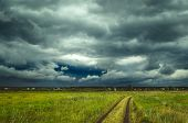 Dark Rain Storm Clouds Over The Field. poster